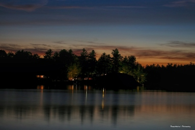 Cottage lights across the lake