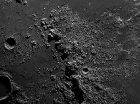 Apinnines Mountains on the lunar surface with small impact craters